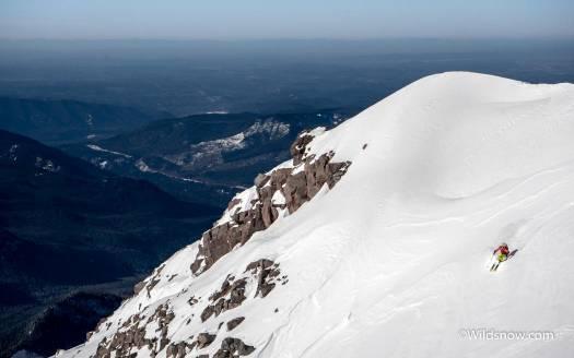 Zack Jessel carving turns high above Oregon.