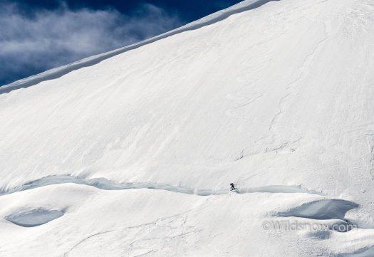 Coop jumping a bergschrund.