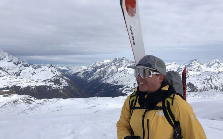 Scott wearing his baby, Futurelight, looking out over the Alps